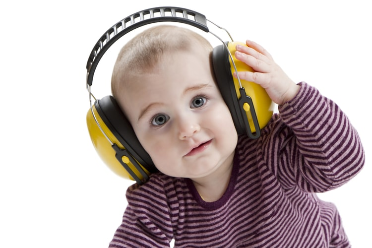 baby with ear defenders